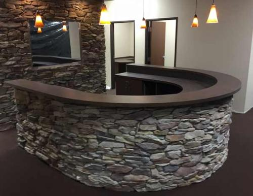 reception desk casework with stone